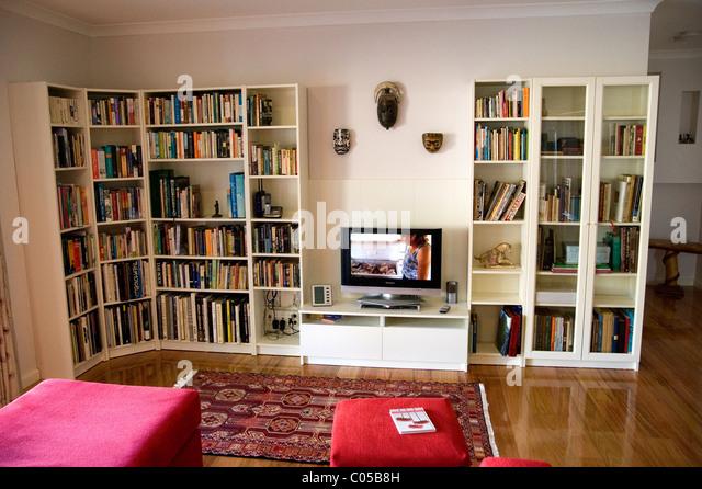 lounge room bookshelves - Stock Image