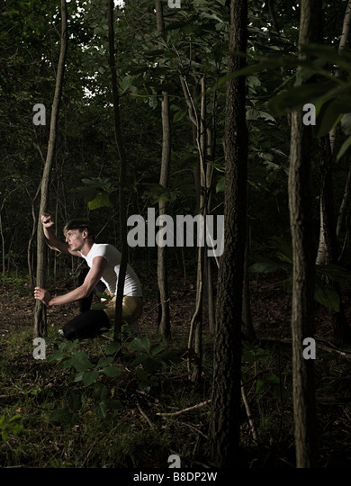 Athlete in forest - Stock Image