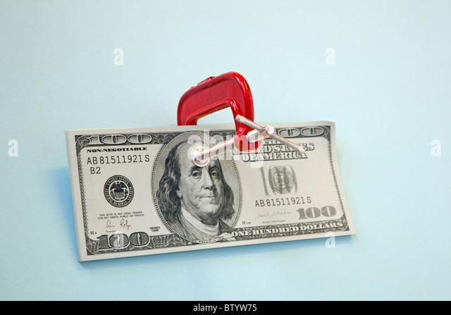 100 dollar bill with clamp on it - Stock-Bilder