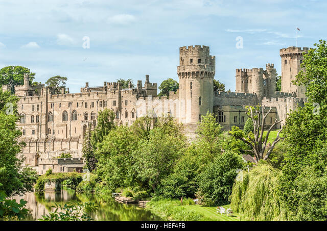 Distant view at Warwick Castle, a medieval castle at the River Avon in Warwick, the county town of Warwickshire, - Stock Image