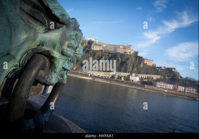 A mooring for boats st the Deutsches Eke with the Ehrenbreitstein Fortress in the background Koblenz, Germany. - Stock Image