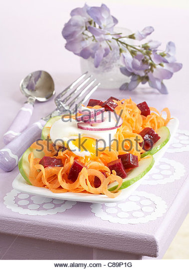 Carrot and beetroot salad with poached egg - Stock Image