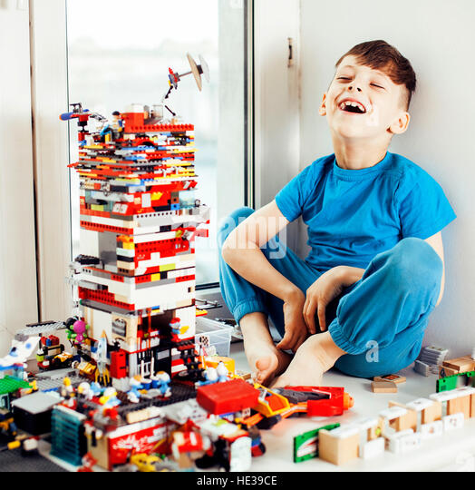 little cute preschooler boy playing with toys at home happy smiling kid, lifestyle people concept - Stock Image