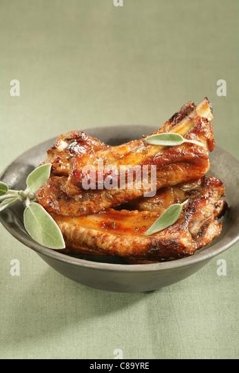 Pork spare ribs caramelized with lavander honey - Stock Image