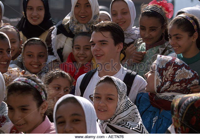Egypt Cairo Egyptian Museum female Muslim students heads covered visiting White male - Stock Image