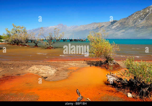 Red sediment in Lake Wakatipu Glenorchy South Island New Zealand - Stock Image