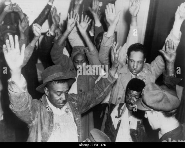 State highway patrolmen search group of Negroes arrested during rioting on Feb. 26, 1946. The Columbia, Tennessee - Stock Image