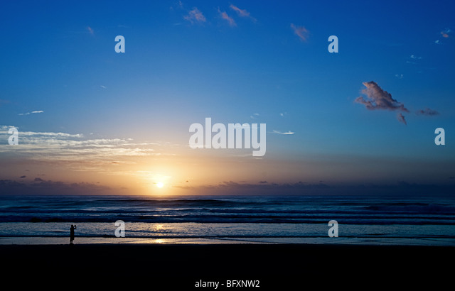 Photography of a Distance Person Photographing the Sunrise on Fraser Island, Queensland, Australia - Stock Image