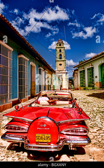 Classic red 1959 beautiful Chevy convertible on cobblestone street of Trinidad Cuba an old colonial village - Stock Image