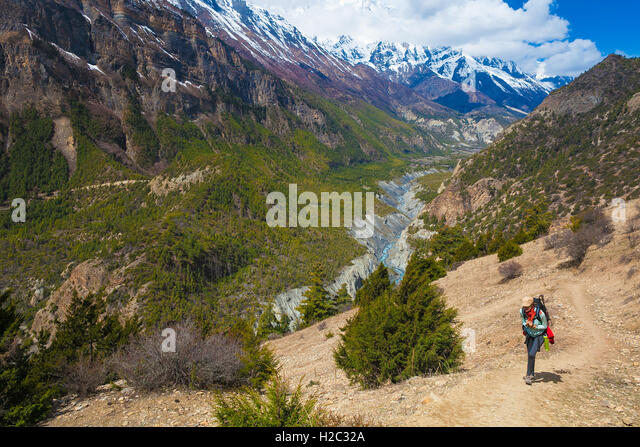 Young Pretty Woman Wearing Blue Jacket Backpack Trail Mountains.Mountain Trekking Rocks Path Landscape View Background. - Stock Image