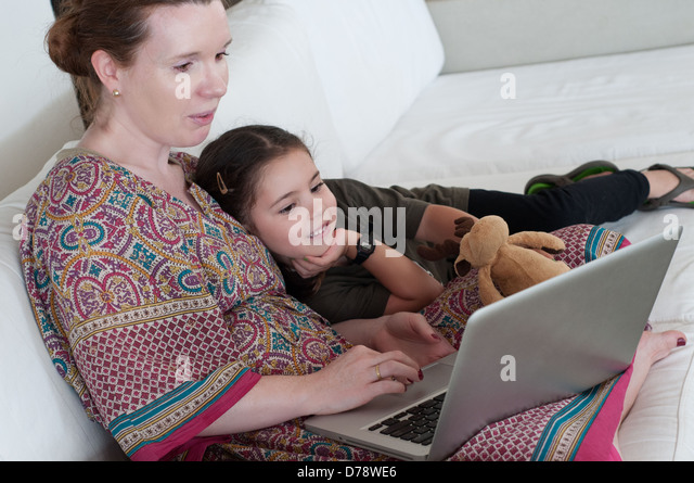 Mother and daughter with laptop - Stock-Bilder