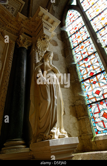 Marble statue inside Lonlay l'Abbaye church, Orne, Normandy, France - Stock Image