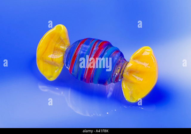 Piece of candy in wrapper - Stock Image