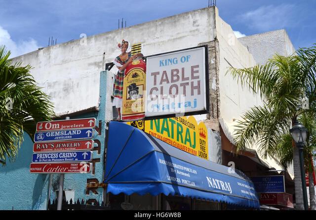 Advertising billboards and signs in Philipsburg, Saint Maarten, Caribbean. - Stock Image