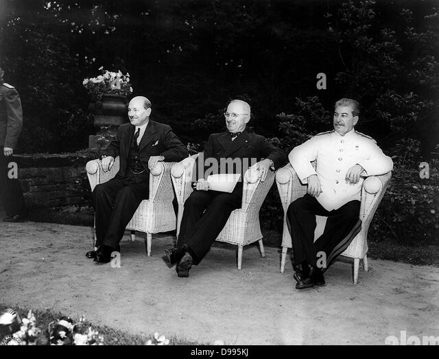 Clement Attlee, Harry Truman, and Joseph Stalin, seated outdoors at the Potsdam (Berlin) conference in 1945 - Stock Image