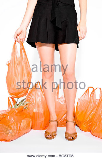 A Young Woman Surrounded By Shopping Bags - Stock Image