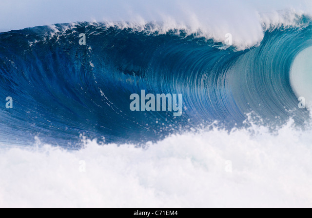 A wave breaking at Off The Wall in Hawaii. - Stock Image