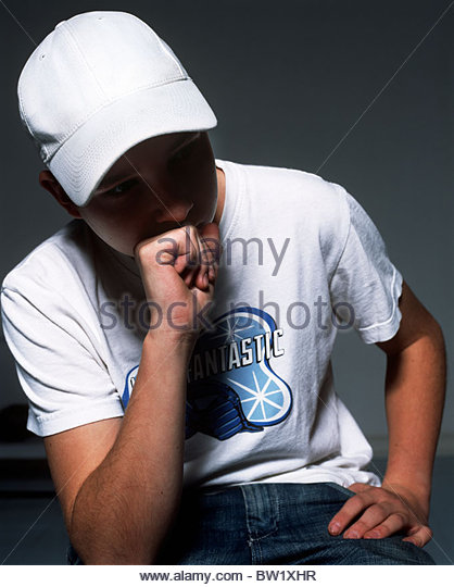 A thinking teenager - Stock Image