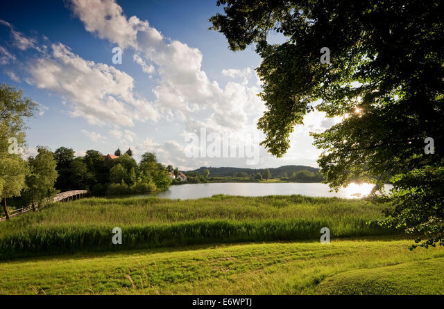 Lake Klostersee and Seeon abbey, Seeon, Chiemgau, Bavaria, Germany - Stock Image