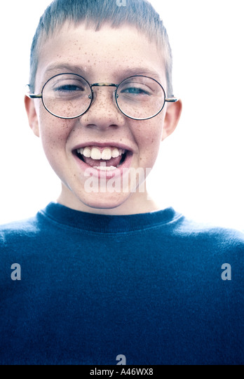 A young boy smiling - Stock Image