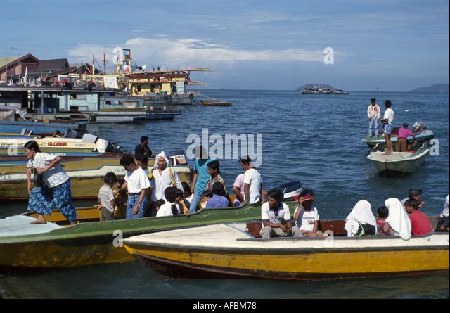 Malaysia Borneo Sabah Kota Kinabalu water taxis boats along Jalan Tun Fuad Stephens - Stock Image