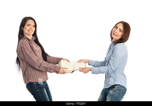 Fight for book two young females pulling book - Stock Image