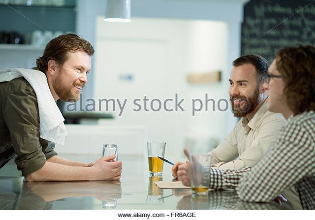 patrons enjoying drinks at diner - Stock Image