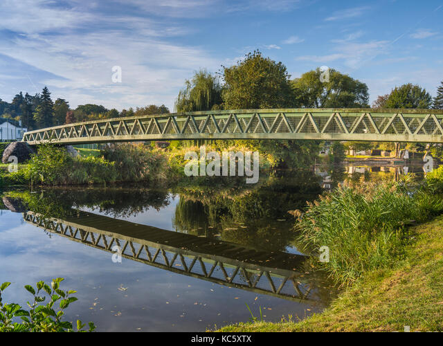 Steel footbridge across river, Preuilly-sur-Claise, France. - Stock Image
