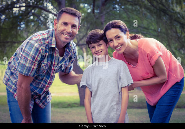 Happy family in the park together - Stock-Bilder
