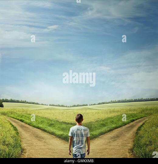 Creative concept with a man in front of two roads choosing the correct way - Stock Image