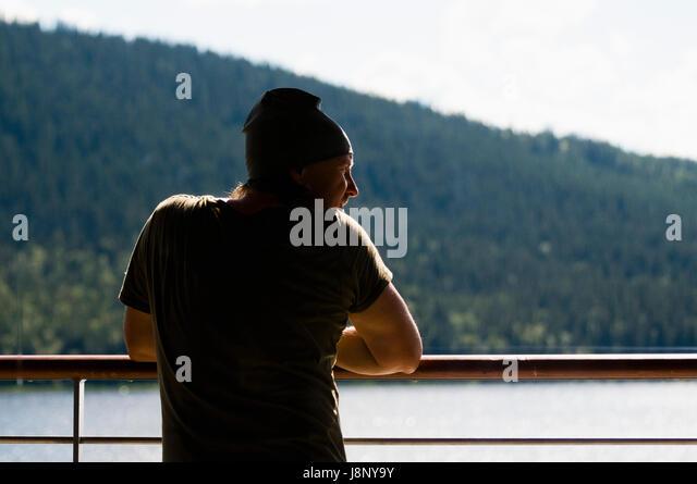 Man leaning on railing - Stock-Bilder