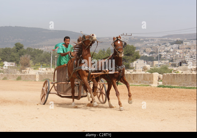 Jerash, Northern Jordan: A charioteer from the Roman Army and Chariot Experience. - Stock Image