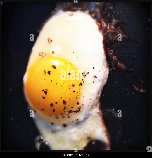 Frying an Egg - Stock Image
