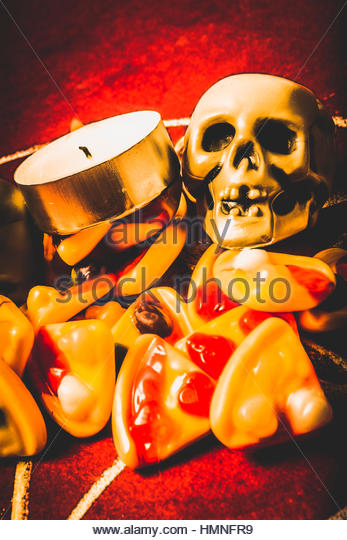 Mystic black circle in witchcraft with a satatic rite of pizzas and skulls - Stock Image