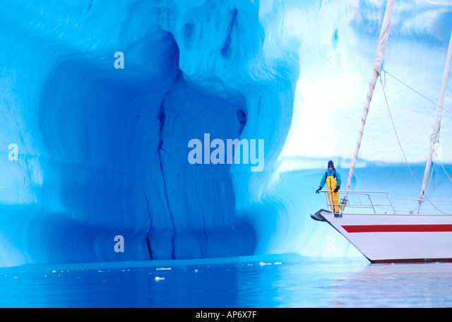 Yacht Pelagic with iceberg in Antarctica - Stock-Bilder