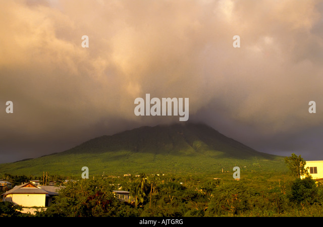 Mount Nevis, landmark green volcano peak, Caribbean, symbol of Island of Nevis St Kitts and Nevis, moody cloud cover - Stock Image