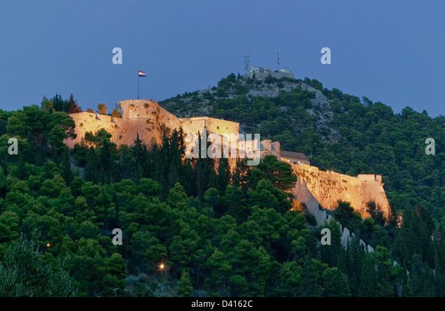 Fort Spanjola at dusk in Hvar, Croatia - Stock Image