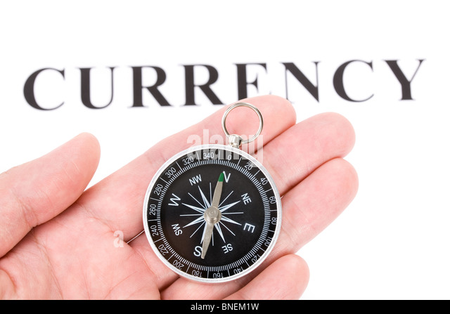 headline currency and Compass, concept of financial decision - Stock Image