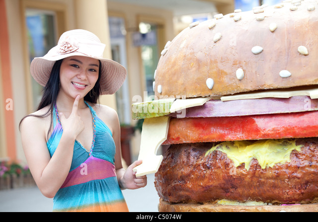 Young Woman Thinking About Food - Stock Image