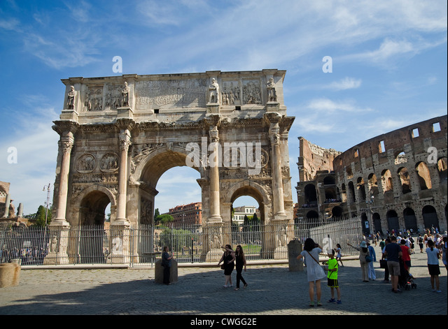 Rome, Italy - August 2012 - Arch of Constantine (Arco di Costantino) with the Coliseum behind. - Stock Image