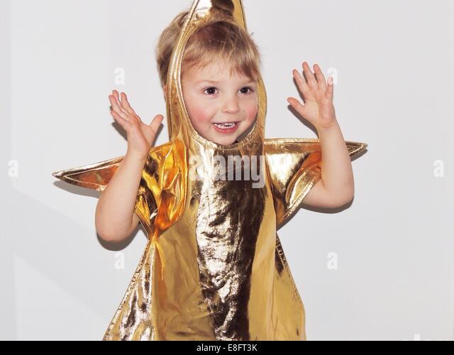 Boy in fancy dress gold star costume - Stock Image