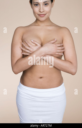 Topless woman covering her breasts - Stock-Bilder