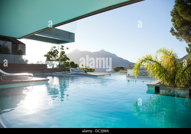 Luxury swimming pool with mountain view - Stock Image
