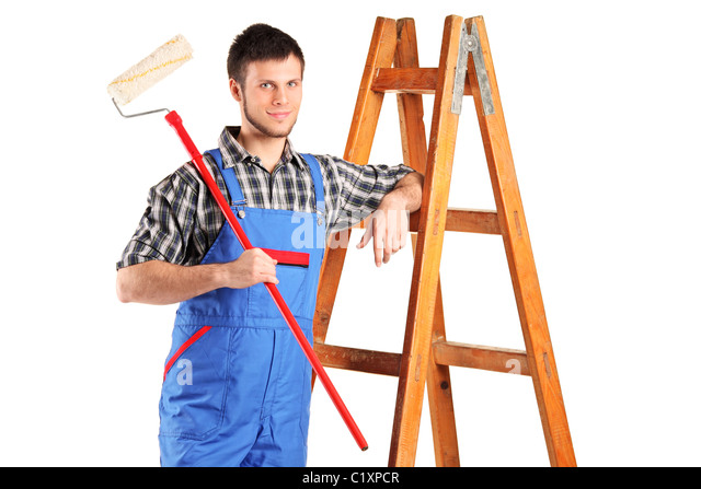 Smiling painter with a paint roller posing - Stock Image