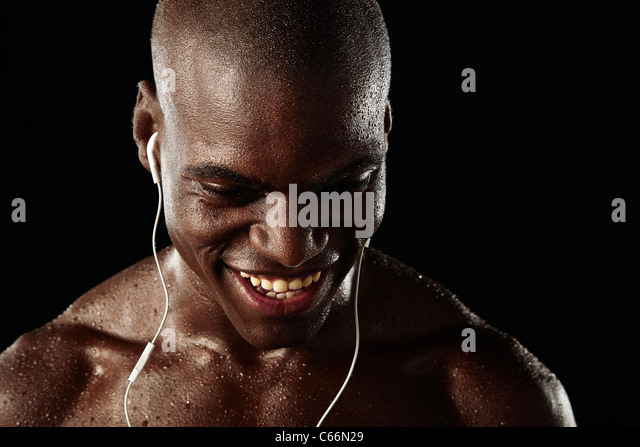 Athlete listening to headphones - Stock Image