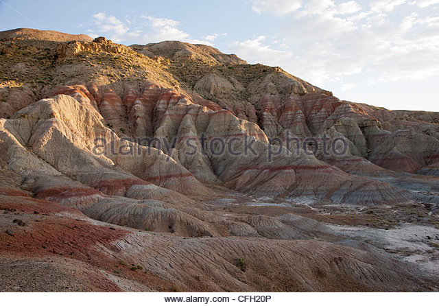 Red rust bands of oxidized soil mark the Paleocene Eocene Thermal Maximum. - Stock Image