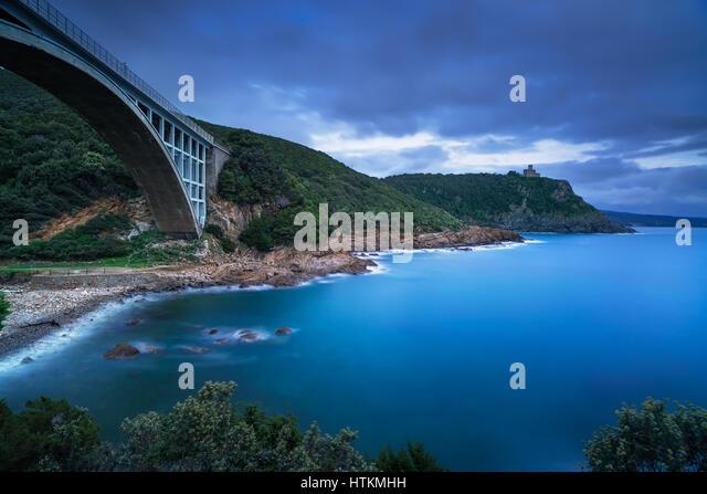 Bridge, cliff and sea. Leghorn coast, Tuscany riviera, Italy, Europe. Long Exposure. - Stock Image