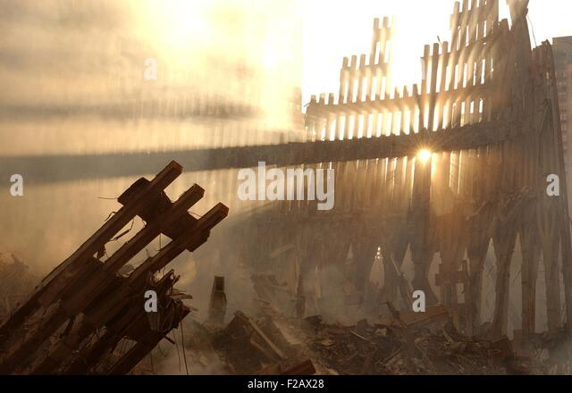 Sun streams through the dust over the wreckage of the World Trade Center. New York City, Sept. 15, 2001. (BSLOC - Stock-Bilder
