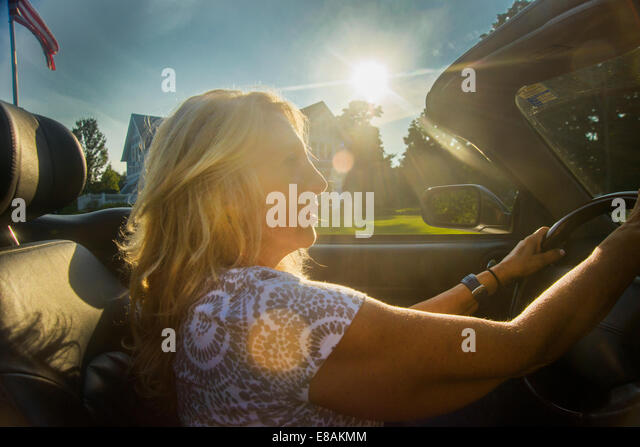 Mature woman driving convertible, Monmouth Beach, New Jersey, USA - Stock Image