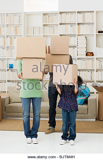 Family with cardboard boxes - Stock Image
